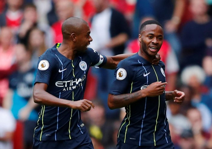 Manchester City's Raheem Sterling celebrates with Fernandinho after scoring their first goal. Reuters