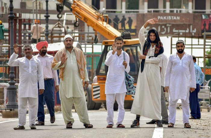 Pakistani prisoners prepare to cross Wagah border as they return after their release by India, ahead of Independence Day, in Attari on Monday. PTI