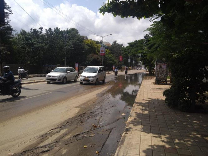 The overflowing stormwater drain on Whitefield Main Road.