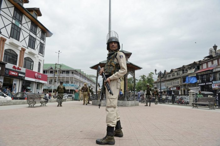 An Indian paramilitary trooper stands guard along a street as security measures beefed-up ahead of Indian Independence day in Srinagar. AFP photo