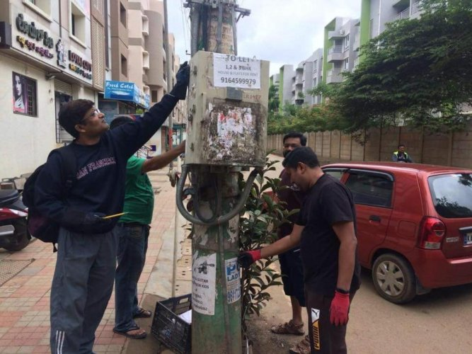 Residents remove posters in Whitefield.