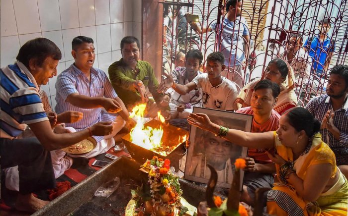 Supporters perform a 'havan' for speedy recovery of the former prime minister Atal Bihari Vajpayee, in Patna on Thursday. PTI Photo