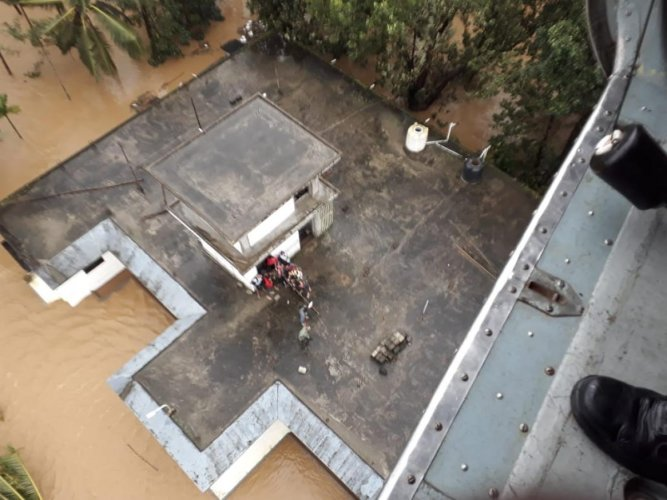 Navy airlift stranded people in Kerala. (ANI Photo)