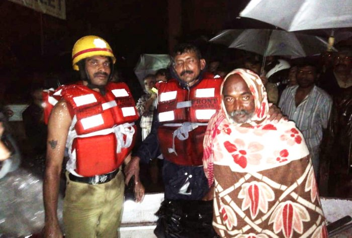 Vinod Mandle from Bihar, who took shelter in a public toilet in Gandhi Maidan, Sringeri, was rescued by the Fire Brigade and ANF staff members.