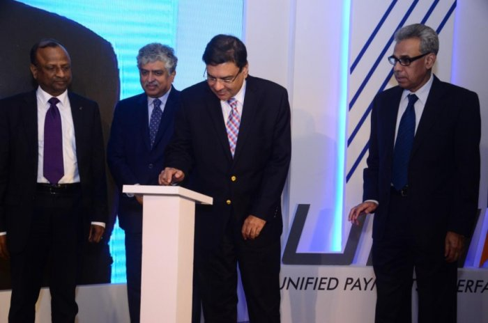Reserve Bank of India Governor Urjit Patel, NPCI Advisor-Innovation Nandan Nilekani, and SBI Chairman Rajnish Kumar are seen at the launch of UPI 2.0.