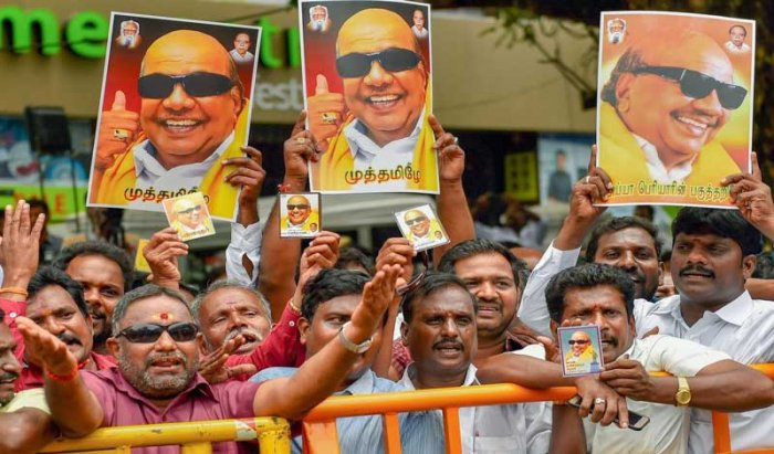 DMK supporters gather near the Kauvery Hospital where DMK President M Karunanidhi in undergoing treatment, in Chennai on Tuesday, Aug 7, 2018. Supporters have started thronging the hospital after Karunanidhi's conditions, reportedly, deteriorated on Monday. (PTI Photo)