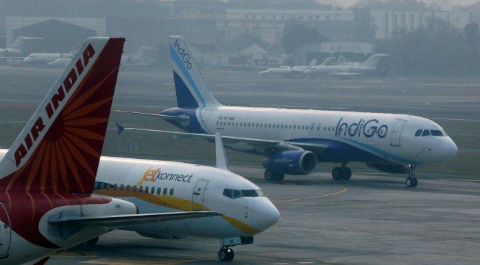 An IndiGo Airlines Airbust A320 aircraft and JetKonnect Boeing 737 aircraft taxi past an Air India Airbus A321 aircraft at Mumbai's Chhatrapathi Shivaji International Airport. REUTERS