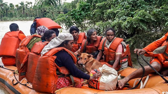 NDRF personnel rescue the flood-hit people in Wayanad, Kerala. PTI photo