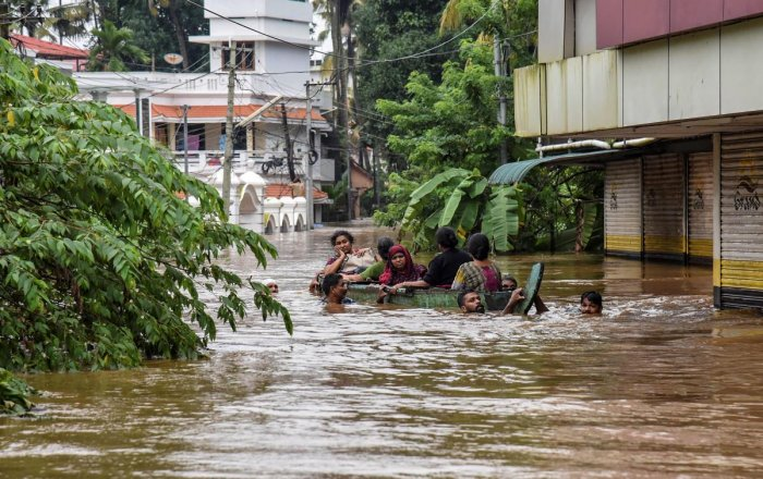 People being rescued from a flood-affected region following heavy monsoon rainfall, in Kochi on August 16. PTI