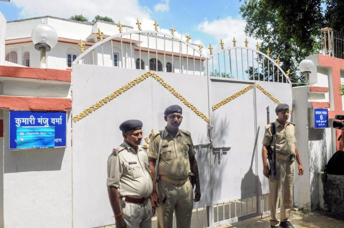 Police personnel outside former social welfare minister Manju Verma's residence during Central Bureau of Investigation (CBI) raid in connection with Muzaffarpur shelter home rape case, in Patna on Friday. (PTI Photo)