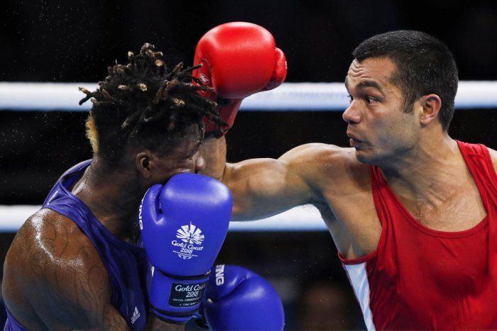 Indian boxer Vikas Krishan (red) is confident of doing well at the Asian Games. AFP File photo.