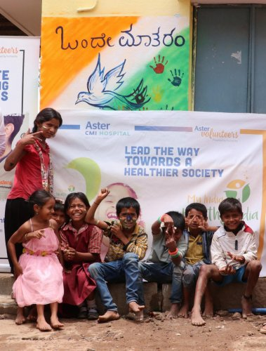 Students outside the school's refurbished wall in Hebbal on Wednesday.