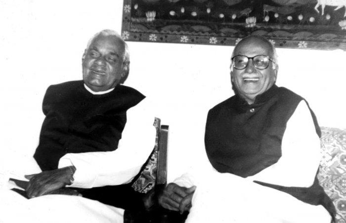 BJP patriarchs Atal Bihari Vajpayee and Lal Krishna Advani share a light moment. (DH Archives)