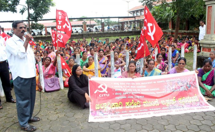 Beedi workers conduct a protest under the aegis of beedi workers federation (CITU), in front of DC's office in Udupi on Saturday.