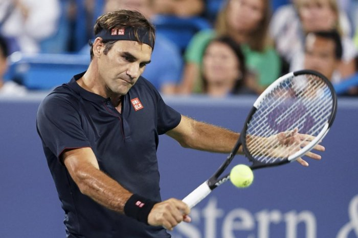 Roger Federer returns to Stan Wawrinka during the quarterfinals of the Western & Southern Open tennis tournament on Friday. (AP/PTI Photo)