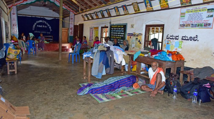 Rain victims at a gruel centre opened at the Government Higher Primary School, at Sampaje in Dakshina Kannada.