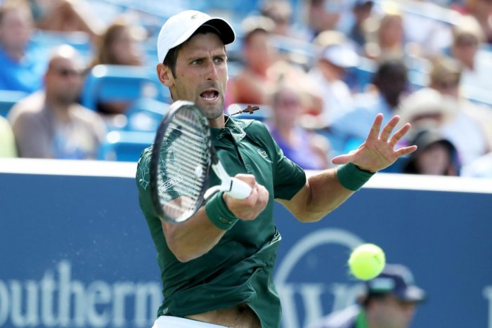GUTSY: Novak Djokovic of Serbia returns during his win over Marin Cilic of Croatia in the men's semifinal. AFP
