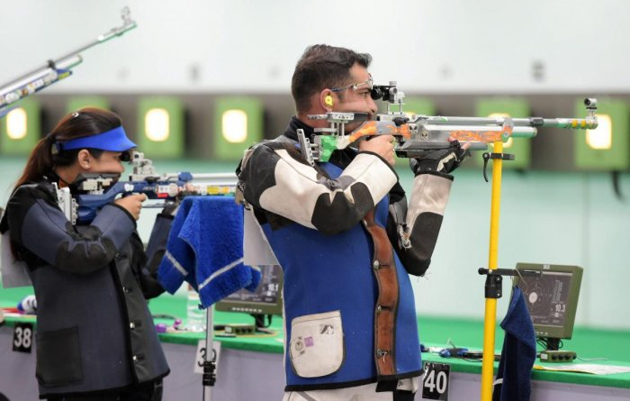 Indian shooters Ravi Kumar and Apurvi Chandela compete in the qualification 10m Air Rifle Mix Team event during the 18th Asian Games Jakarta Palembang, in Indonesia on Sunday. (PTI Photo)