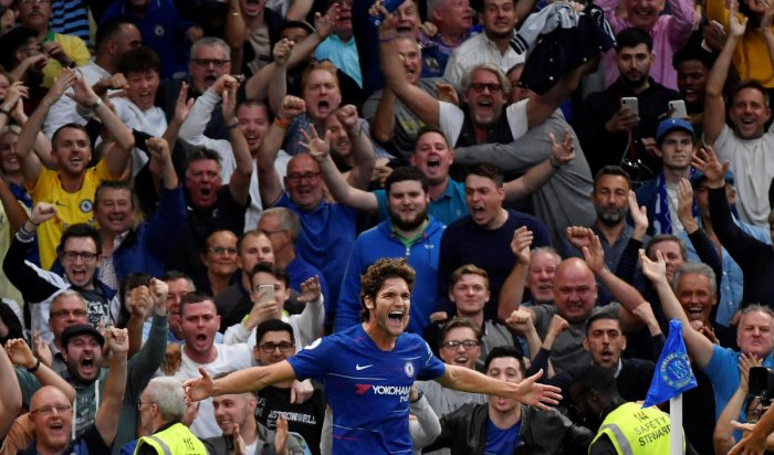 SEALED THE DEAL Chelsea's Marcos Alonso (centre) celebrates scoring his side's third goal. REUTERS