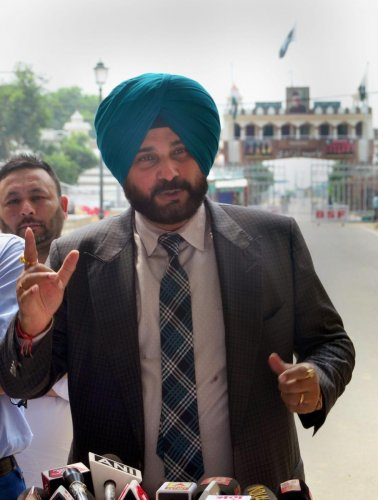 Punjab cabinet minister Navjot Singh Sidhu addresses the media on his arrival after attending the swearing-in ceremony of Pakistan Prime Minister Imran Khan, in Attari on Sunday, Aug 19, 2018. (PTI Photo)