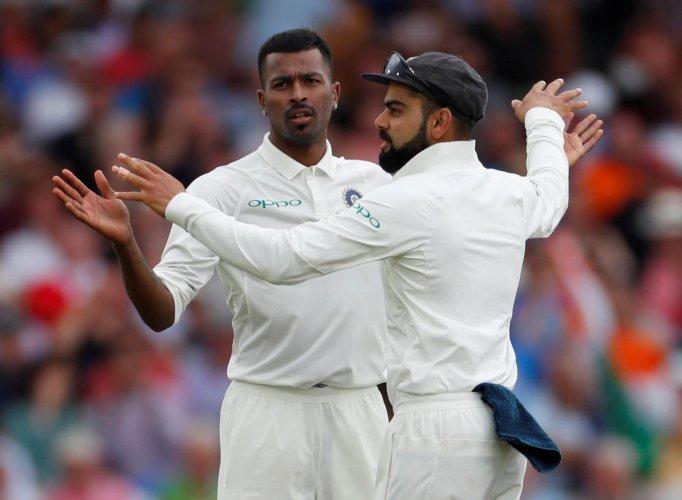 India's Hardik Pandya celebrates with Virat Kohli after taking the wicket of England's Adil Rashid. (Reuters)