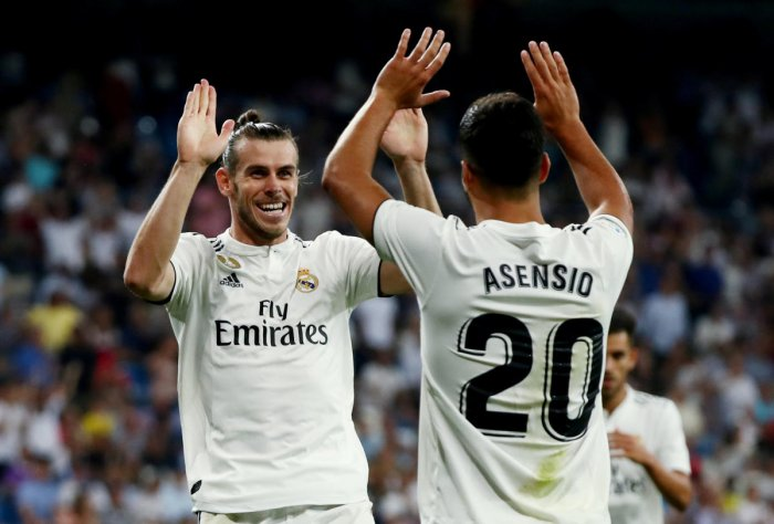 Real Madrid's Gareth Bale celebrates scoring their second goal with Marco Asensio. (REUTERS)