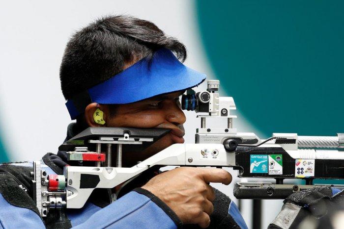 Deepak Kumar of India competes. (REUTERS)