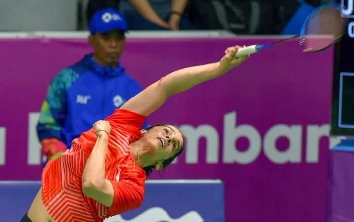Indian shuttler Saina Nehwal in action against Japan player Nozomi Okuhara (unseen) at Women's Team quarterfinals event during the 18th Asian Games Jakarta Palembang 2018, in Indonesia on Monday, Aug 20, 2018. (PTI Photo)