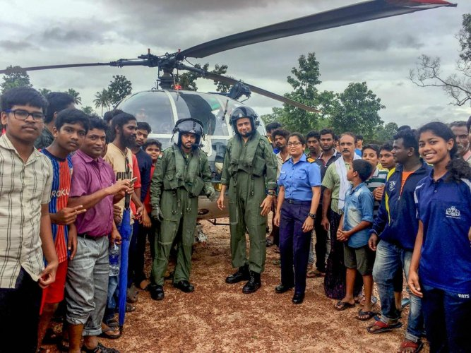 Rescue teams and local panchayat representatives involved in evacuating people from landslip-prone areas to relief camps at Kottayam district in Kerala, pose for a group photo on Monday, Aug. 20, 2018. (Coast Guard via PTI )