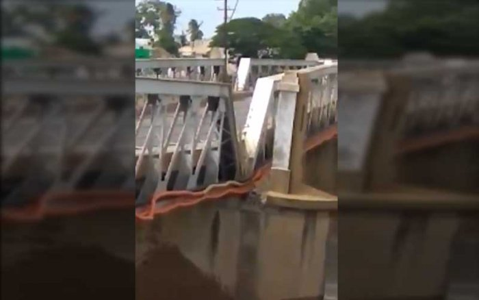 A portion of a 90-year-old steel bridge across Kollidam river that connects Srirangam with mainland Tiruchirapalli, which was abandoned in 2016, collapsed and washed away in the floods early Sunday. Picture courtesy Twitter