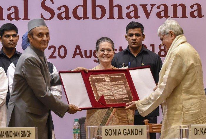Former Congress president Sonia Gandhi and party veteran Karan Singh present Rajiv Gandhi National Sadbhavana Award to former West Bengal governor Gopalkrishna Gandhi during the award function, in New Delhi on Monday. PTI