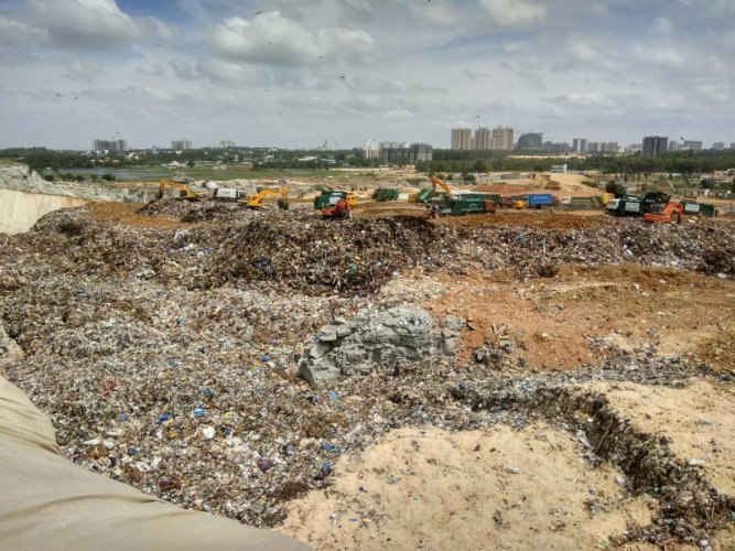 The abandoned quarry in Bellahalli is being filled with mixed waste in violation of NGT orders.