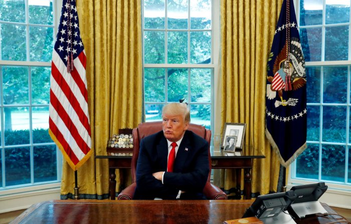 US President Donald Trump reacts to a question during an interview with Reuters in the Oval Office of the White House in Washington, U.S. August 20, 2018. (REUTERS)