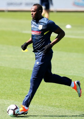 Usain Bolt during a training session with A-League football club Central Coast Mariners on Tuesday. AFP
