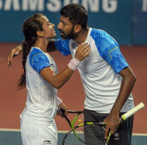India mixed doubles pair of Rohan Bopanna (right) and Ankita Raina celebrate after beating Na RJ Kim and Jeamoon Lee of Korea on Tuesday. PTI