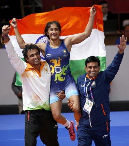 Vinesh Phogat celebrates after winning gold medal in 50kg category. REUTERS