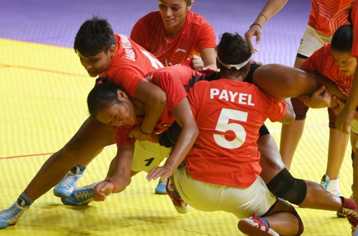 NO WAY OUT Indian players tackle Indonesia's Laraswati Ni Putu Dewi (centre) during their clash on Tuesday. AFP