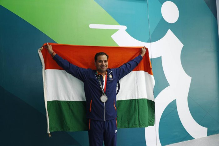Silver medallist Sanjeev Rajput of India holds up his national flag. Reuters photo