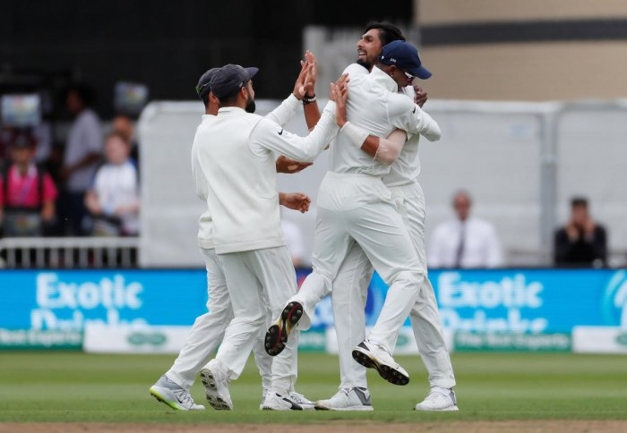 Ishant Sharma celebrates with teammates after taking the wicket of England's Alastair Cook. Reuters file photo