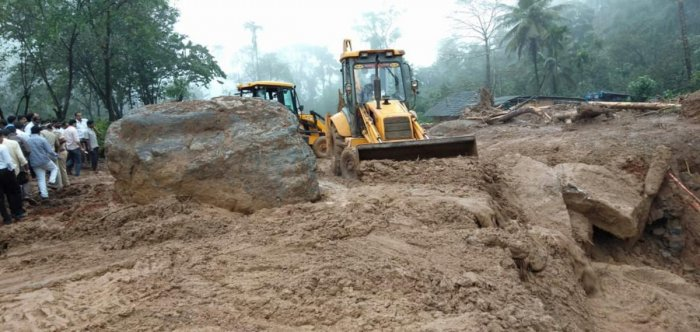 The work on clearing the boulders in progress at Jodupala, Kodagu district.