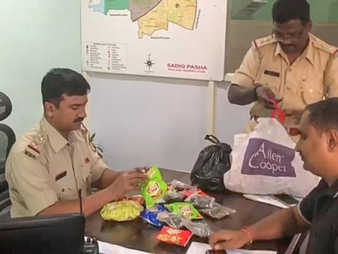 Police seizing 2 kg of ganja concealed in Lays and Kurkure packets on Tuesday evening.