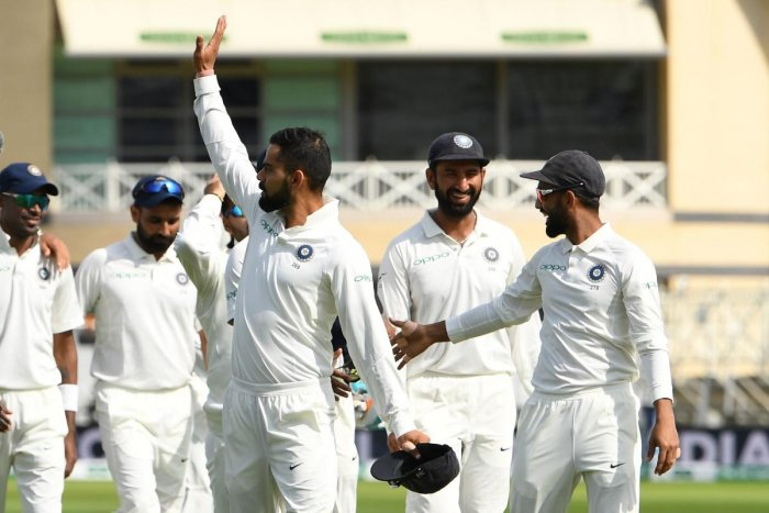 India's captain Virat Kohli (centre) waves to the crowd after winning the third Test against England on Wednesday. AFP