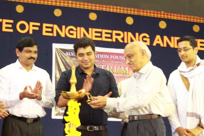 ISRO former chairman Dr A S Kiran Kumar inaugurates the speakers' club of Alva's Education Foundation at Mijar. Alva's Education Foundation Managing Trustee Vivek Alva and others look on. DHPhoto