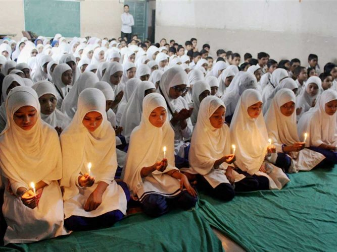 Taking a serious view of alleged opposition by the principal and teachers of a 'madrasa' (Islamic seminary) to the singing of the national anthem during Independence Day function, the Uttar Pradesh government has cancelled its recognition. PTI file photo for representation
