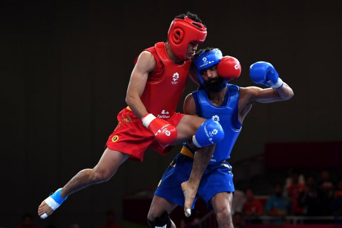 India's Surya Bhanu Partap Singh (right) lost his match in the 60 kg class against Iran's Erfan Ahangarian. AFP FILE PHOTO