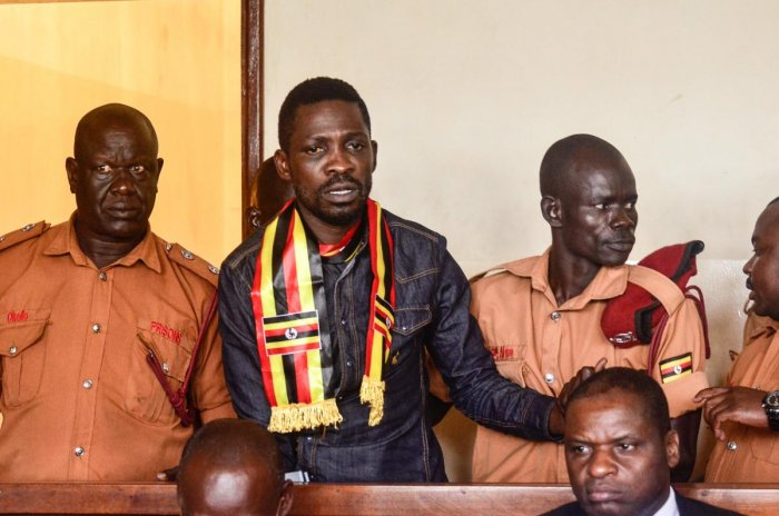 Uganda's prominent opposition politician Robert Kyagulanyi known as Bobi Wine appears at the chief magistrate court in Gulu, northern Uganda, on August 23, 2018. AFP