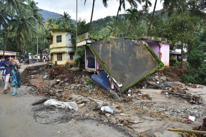 A view of the houses that were severely damaged in flash floods at Kannappanakundu,Kozhikode district in Kerala, on Wednesday. DH PHOTO BY JANARDHAN B K
