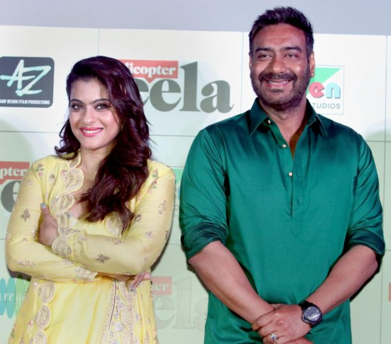 Bollywood actors Kajol Devgn and Ajay Devgn pose for a picture as they celebrate the formers 43rd birthday during the trailer launch of their upcoming Hindi film 'Helicopter Eela', in Mumbai on August 05, 2018. (PTI File Photo)