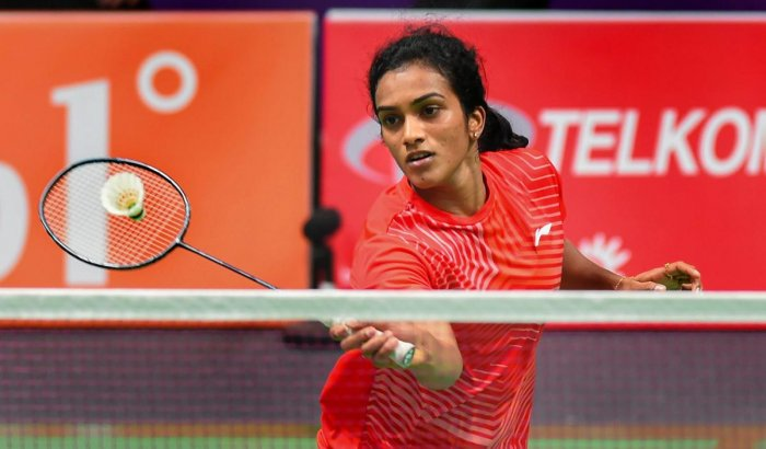 STRUGGLE: India's PV Sindhu in action against Vu Thi Trang of Vietnam in the women's singles badminton match in Jakarta on Thursday. PTI