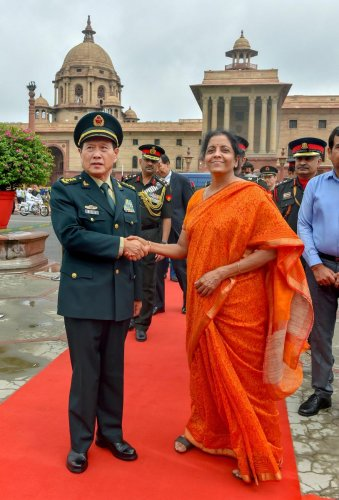 Defence Minister Nirmala Sitharaman welcomes her Chinese counterpart General Wei Fenghe at the South Block in New Delhi on Thursday. PTI